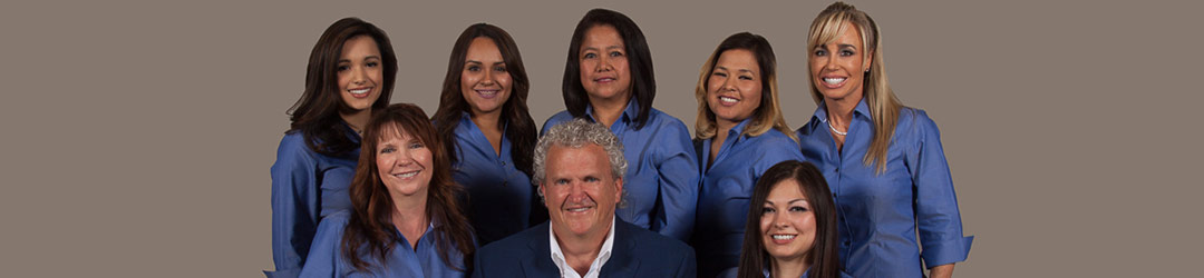 Odessa Dentist Dr. Steve Cobb & his team smiling for a photo