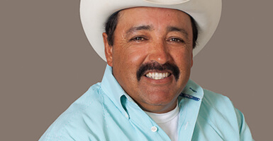Man with a cowboy hat on smiling