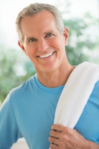 smiling man with towel on shoulder